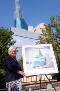 Kildonan-St. Paul MP Joy Smith with the new stamp commemorating the opening of the Canadian Museum for Human Rights.