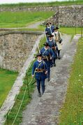 Interpreters dressed as soldiers at Fort Louisbourg go about their daily routine.