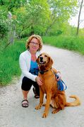Royalwood artist Cindy Dyson at her favourite place — Bois-des-Esprits, part of the Seine River Greenway — with her dog, Dudley.