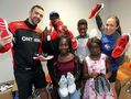 Athletes donate shoes to provide kids with sound footing