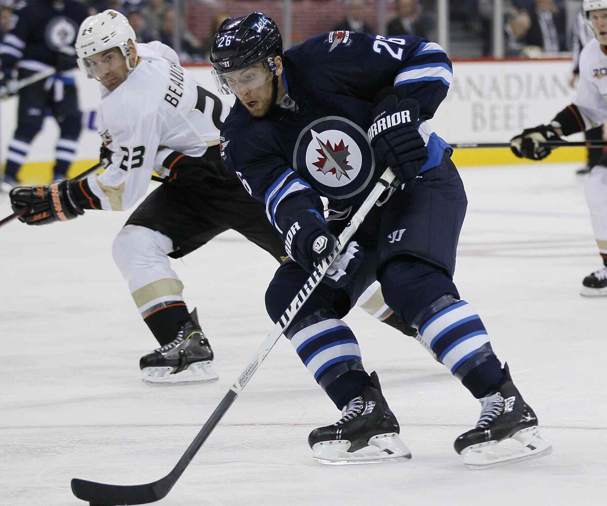 Anaheim Ducks' Francois Beauchemin keeps a eye on Winnipeg Jets' Blake Wheeler as he moves in on a breakaway during the second period. (JOHN WOODS / WINNIPEG FREE PRESS)