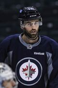 Winnipeg Jets captain Andrew Ladd wears the battle scars from Saturday's game against the Wild into practice Sunday at the MTS Centre.
