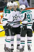 Stars Brenden Dillon (4), Jamie Benn (14) and Tyler Seguin (91) celebrate Benn's first-period goal.