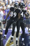 Baltimore Ravens wide receiver Steve Smith (89) celebrates his touchdown with teammate Marlon Brown during the first half of an NFL football game against the Carolina Panthers in Baltimore, Sunday, Sept. 28, 2014. (AP Photo/Gail Burton)