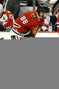 Chicago Blackhawks right wing Patrick Kane (88) skates back to the bench after sustaining an injury during the first period of an NHL hockey game against the Florida Panthers on Tuesday, Feb. 24, 2015, in Chicago. (AP Photo/Andrew A. Nelles)