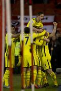 Tottenham's Christian Eriksen, bottom right, celebrates with teammates after scoring his second goal during the English League Cup Semi-Final second leg soccer match between Sheffield United and Tottenham at Bramall Lane Stadium, Sheffield, England, Wednesday, Jan. 28, 2015. (AP Photo/Jon Super)