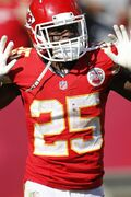 Kansas City Chiefs running back Jamaal Charles (25) celebrates his touchdown against the St. Louis Rams in the second half of an NFL football game in Kansas City, Mo., Sunday, Oct. 26, 2014. (AP Photo/Colin E. Braley)