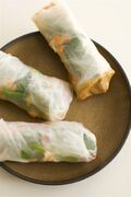 In this image taken on May 13, 2013, summer rolls with spicy peanut dipping sauce are shown served on a plate in Concord, NH. (AP Photo/Matthew Mead)