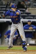 New York Mets Wilmer Flores is struck in the ankle by a pitch thrown by New York Yankees relief pitcher Andrew Miller in the ninth of a baseball game at Yankee Stadium in New York, Sunday, April 26, 2015. (AP Photo/Kathy Willens)