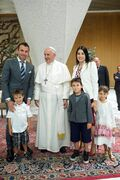 In this photo provided by the Vatican paper L'Osservatore Romano, Pope Francis poses with Italian soccer player Alessandro Del Piero and his family, in the Paul VI hall at the Vatican, Monday, Sept. 1, 2014 ahead of an inter-religious match for peace. The friendly soccer match, supported by Pope Francis to promote the dialogue and peace among different religions, is scheduled at Rome's Olympic stadium later Monday. (AP Photo/L'Osservatore Romano)