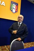 In this picture taken Friday, July 25, 2014, Carlo Tavecchio attends a National Amateur League meeting in Rome. FIFA has asked the Italian football federation to open an investigation into alleged racist comments made by FIGC presidential candidate Carlo Tavecchio.