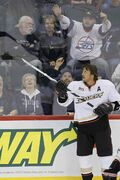 Anaheim Ducks' Teemu Selanne tosses a puck to fans during the pre-game skate of their NHL game against the Winnipeg Jets at the MTS Centre Sunday.