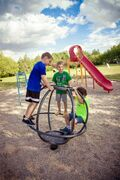 Jesse (left), Jackson and Colton play on one of the new pieces of playground equipment recently installed at Nicole Park in the RM of Cartier.