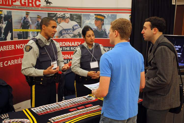 RCMP Consts. Ron Bumbry and Izza Mian make pitch to education students Dale Tanner, Gilli Braunstein.