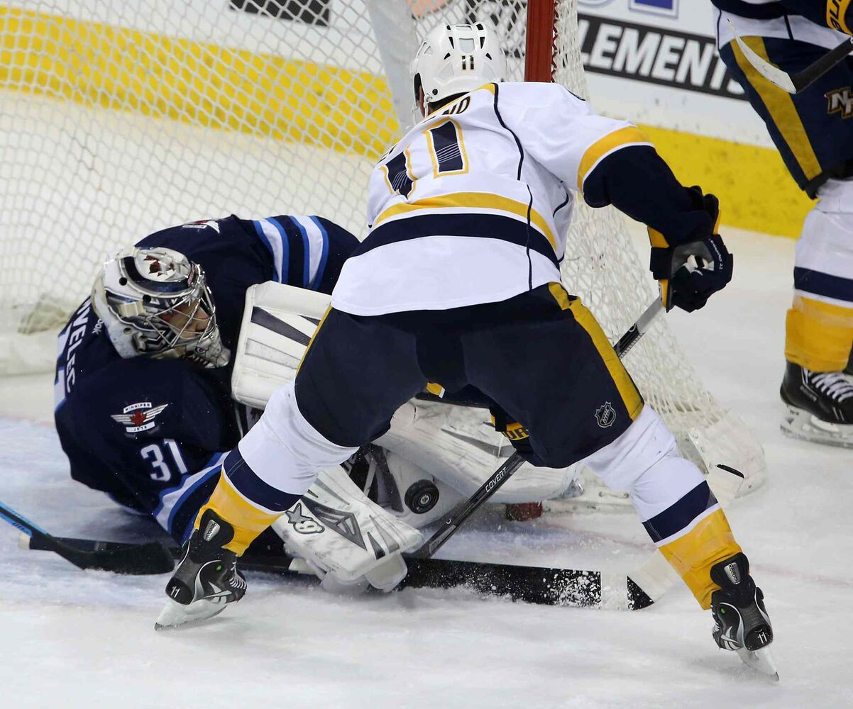 Winnipeg Jets' goaltender Ondrej Pavelec (31) stops Nashville Predators' David Legwand (11) right in front of the net during first period in Winnipeg Tuesday. (Trevor Hagan / The Canadian Press)