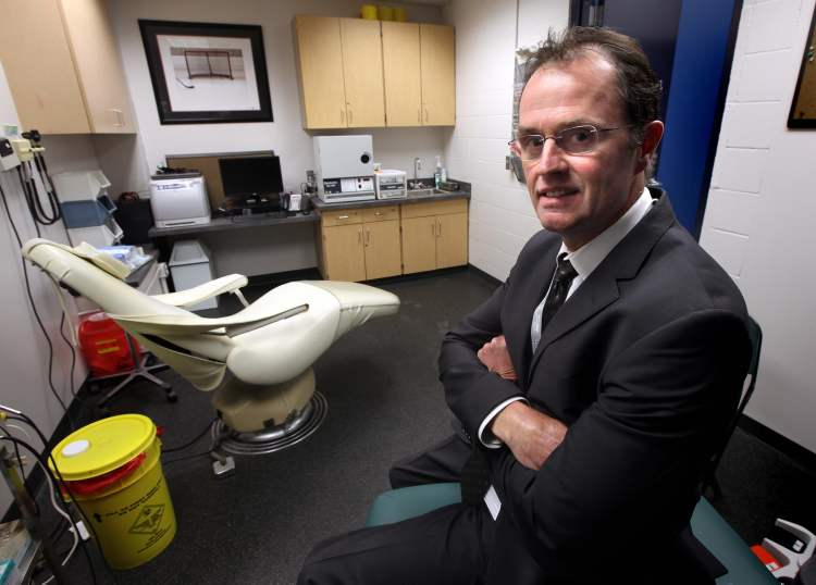 Dr Peter MacDonald, Jets' physician, poses in the team's medical room at the MTS Centre.