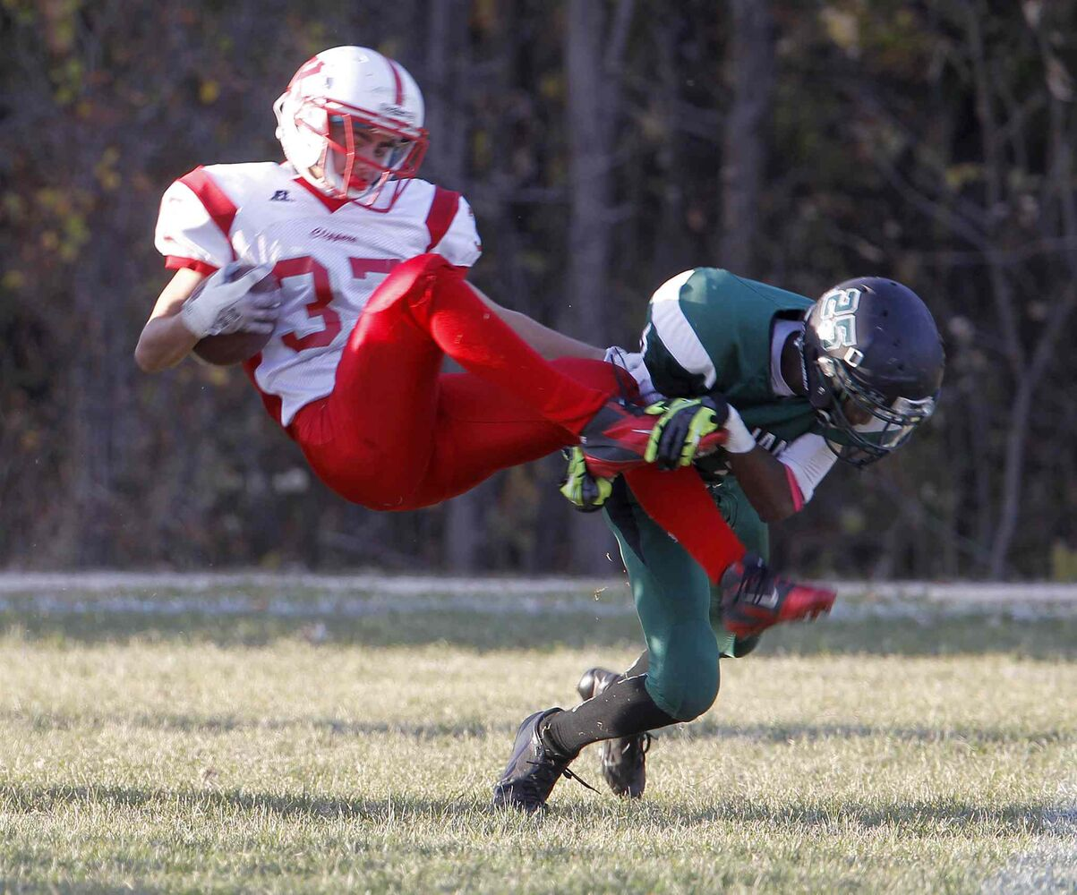 Kelvin Clippers' Jack Syverson is tackled by Vincent Massey Trojans' Abdul Gassama. (TREVOR HAGAN / WINNIPEG FREE PRESS)