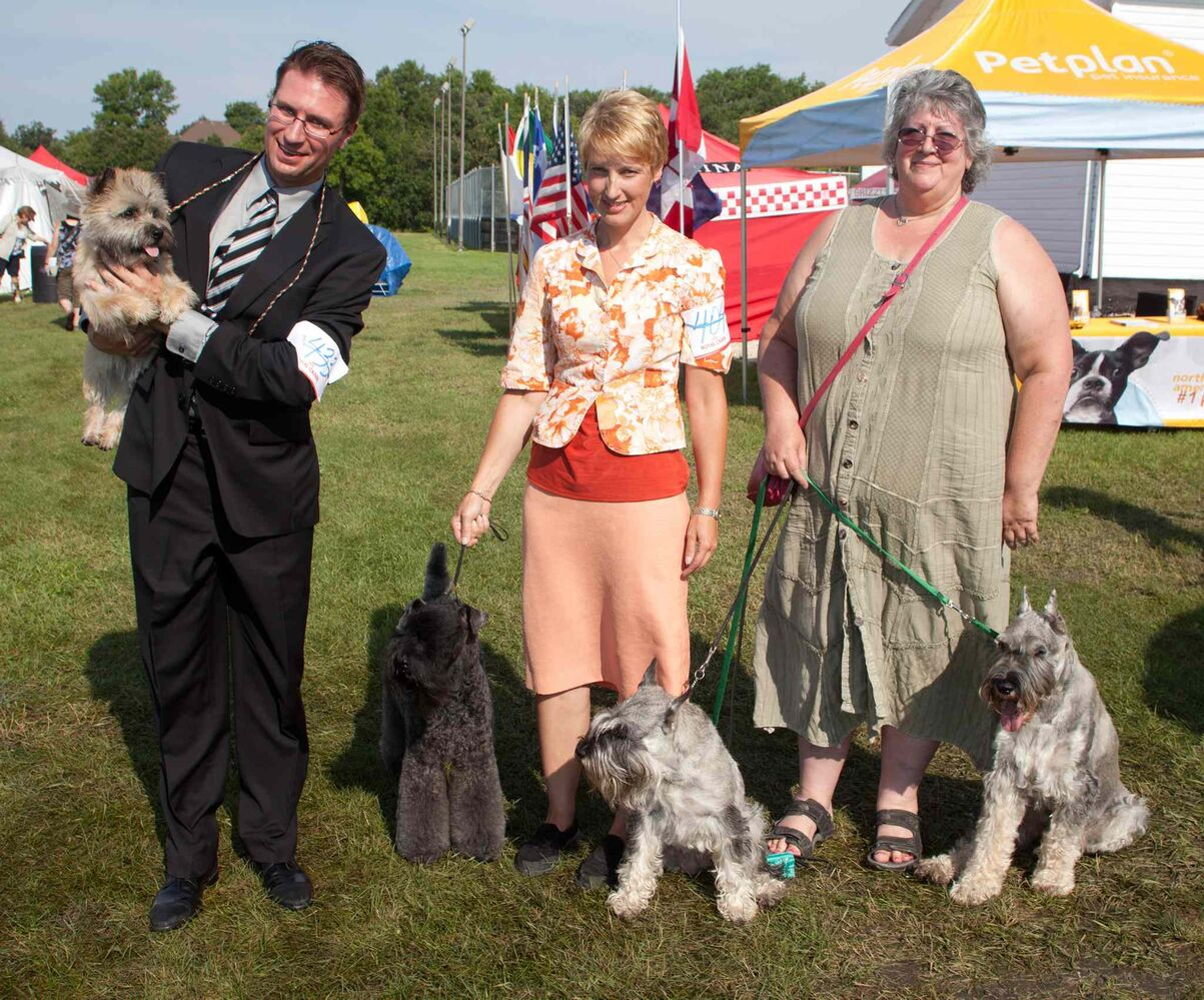 The 40th annual Manitoba Canine Association (MCA) show runs Aug. 13 to Aug. 16 at the East St. Paul Community Centre. This year's show is a memorial for David Markus, one of the founders of the MCA. The show features dogs of all breeds from across North America and overseas. Some of the proceeds from this year's event will go toward buying a vest for a local police dog. Pictured, from left, are Kyle Sabourin with Maska, Connie Krohn with Kerry, and Heather Pedersen with Très Bien and Mack, on Aug. 14, 2015. (JOHN JOHNSTON / WINNIPEG FREE PRESS)