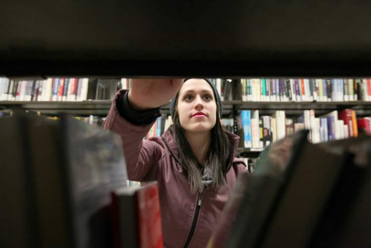 Winnipeg operates 20 libraries and maintains miles of bookshelves in the Internet age.
