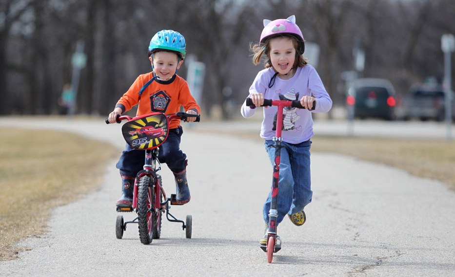 Petra Steadwell and her brother Scott keep their heads protected in Assiniboine Park last March. There's no date for the new helmet law to take effect.