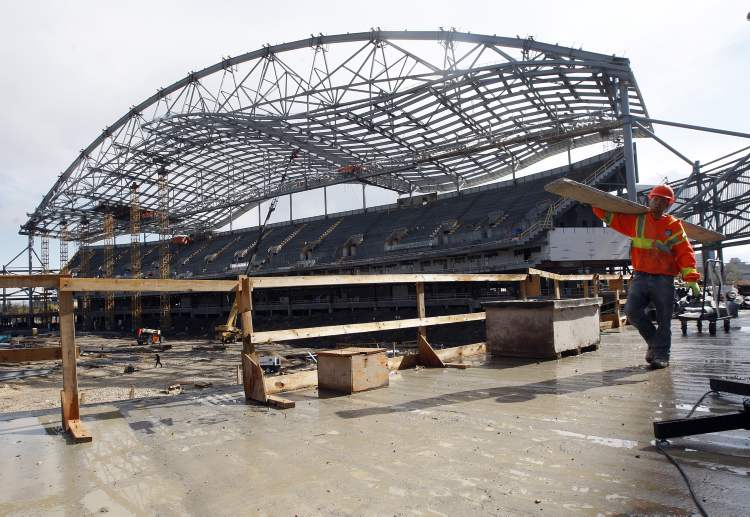 Work continues as Bomber announce two  possible opening game dates for the new stadium at Investors Group Field.
