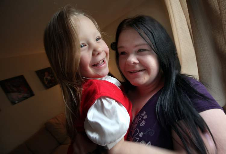 Ashley Harvey, 24, with her daughter Rain, 4.