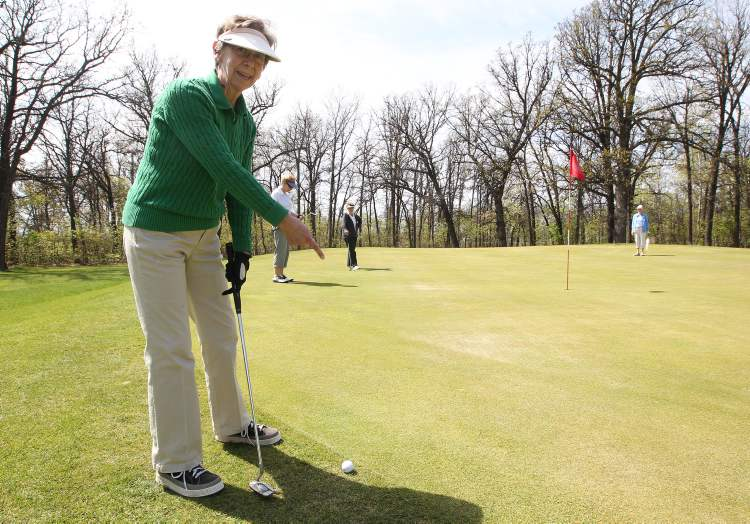 Betty Grant points out a subtle break on the green during a game with friends at the  Windsor Park Municipal Golf Course.