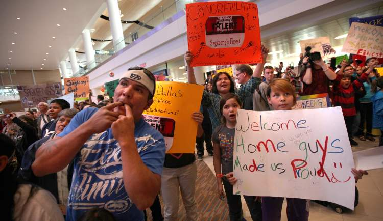 Hundreds of well-wishers wait for the arrival of members of Sagkeeng's Finest at Richardson International Airport Tuesday evening.