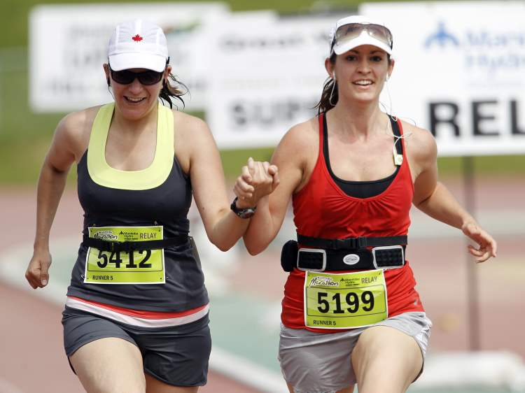 Relay participants near the finish line. (TREVOR HAGAN / WINNIPEG FREE PRESS)