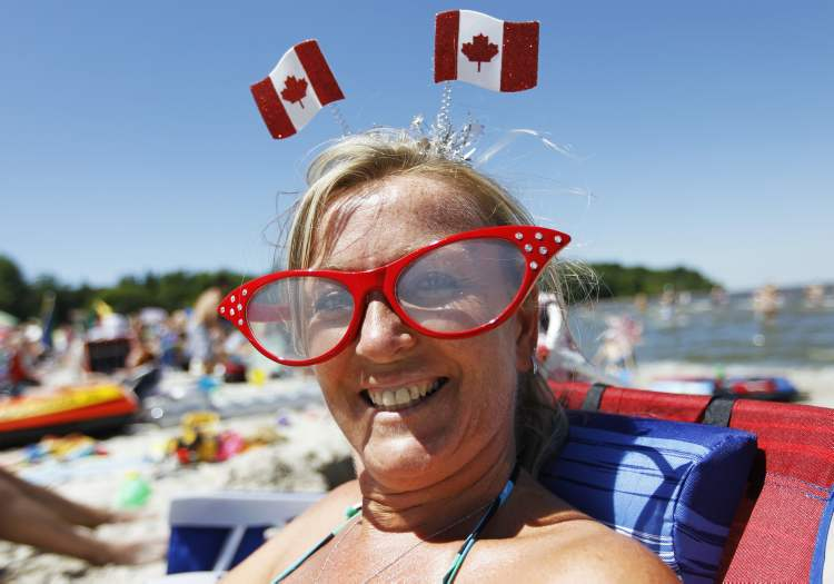 Isabelle Tomchuk was among thousands enjoying the sunshine at Grand Beach on Canada Day. (TREVOR HAGAN / WINNIPEG FREE PRESS)