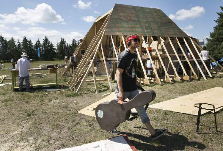 Nick Naylor arrives at The Castle Boys' area in the campground at Birds Hill Park Wednesday afternoon. The group of campers were setting up a Tribal Nexus and planned to have a drum band perform on their stage. (Joe Bryksa / Winnipeg Free PRess)