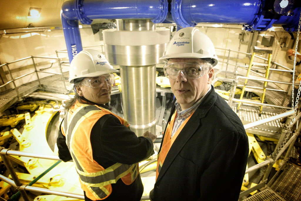Former NCN Chief Jerry Primrose and Premier Greg Selinger get a close look at the working turbine at Manitoba Hydro's Wuskwatim dam in 2012.