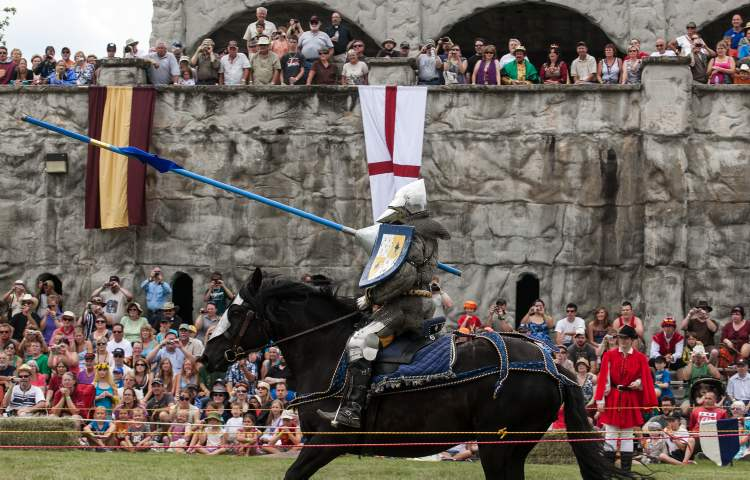 Jordan Heron, from Niagara-on-the-Lake, Ontario, passes the crowd during a joust competition at the 2012 Medieval Festival at the Immaculate Conception Church and Grotto on Saturday in Cooks Creek. (Melissa Tait / Winnipeg Free Press)