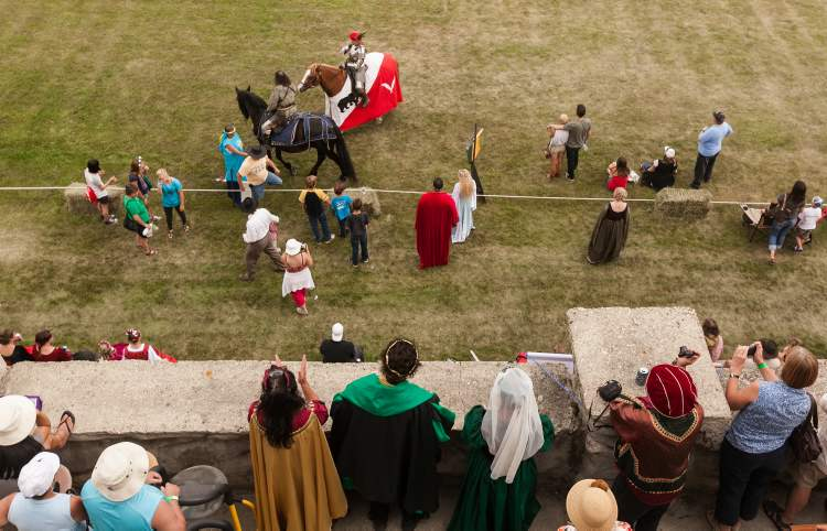 Attendees are seen following the joust demonstration at the 2012 Medieval Festival at the Immaculate Conception Church and Grotto on Saturday in Cooks Creek. (Melissa Tait / Winnipeg Free Press)