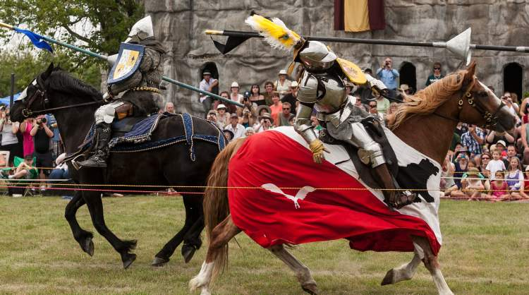 Alison Mercer (right) is knocked hard during a pass in a jousting competition by Jordan Heron. Mercer travelled from Calgary and Heron from Niagara-on-the-Lake, Ontario to joust at the 2012 Medieval Festival at the Immaculate Conception Church and Grotto on Saturday in Cooks Creek.