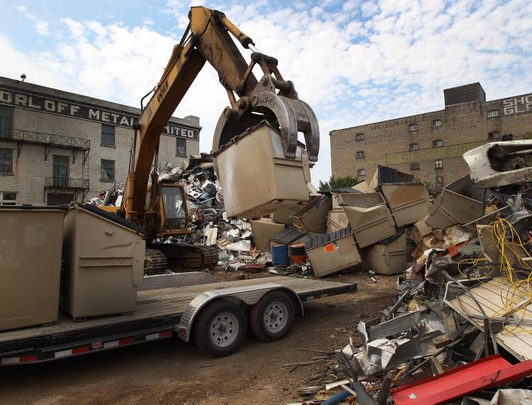 Autobins are slowly being collected by the City of Winnipeg and crushed for scrap. (JOE BRYKSA / WINNIPEG FREE PRESS)