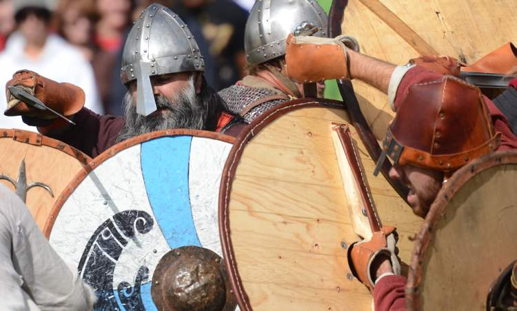 Christian Arel fights from a shield wall in a Viking combat demonstration at the Icelandic Festival in Gimli, Saturday. (COLE BREILAND / WINNIPEG FREE PRESS)