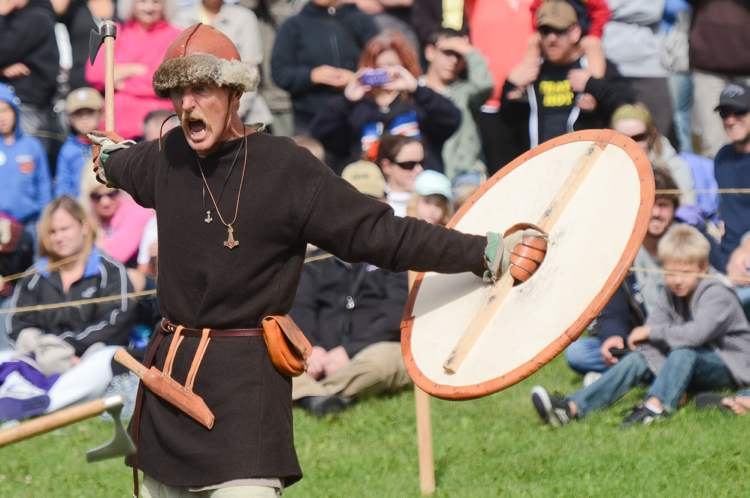 Viking reenactor Tracy Stubbert taunts his opponent during a combat demonstration at the Icelandic Festival in Gimli, Saturday. (COLE BREILAND / WINNIPEG FREE PRESS)