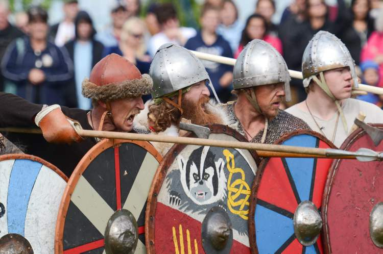 Viking reenactor Tracy Stubbert yells orders at his warriors in a shield wall formation during a combat demonstration at the Icelandic Festival in Gimli, Saturday.