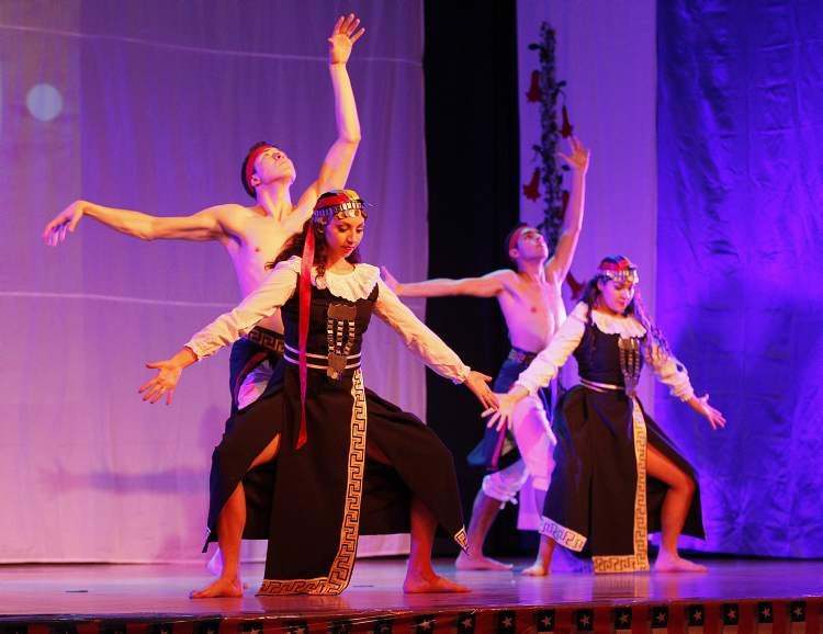 Dancers perform at the Chile Lindo Pavilion Monday, August 13, 2012.