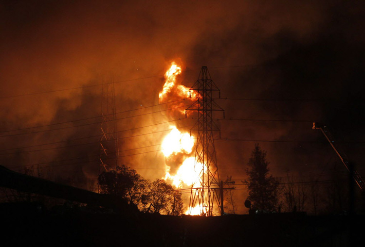 The fire in the St. Boniface-area industrial park is seen after dark. (Boris Minkevich / Winnipeg Free Press)
