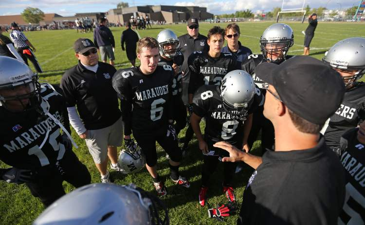 A Maples Marauders coach addresses the team during the first half as they played the West Kildonan Wolverines at Maples Collegiate.
