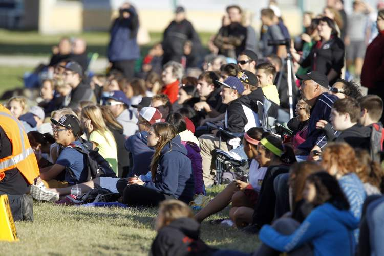Spectators watch as the Garden City Gophers defeat the Dakota Collegiate Lancers 13-12.  (TREVOR HAGAN / WINNIPEG FREE PRESS)