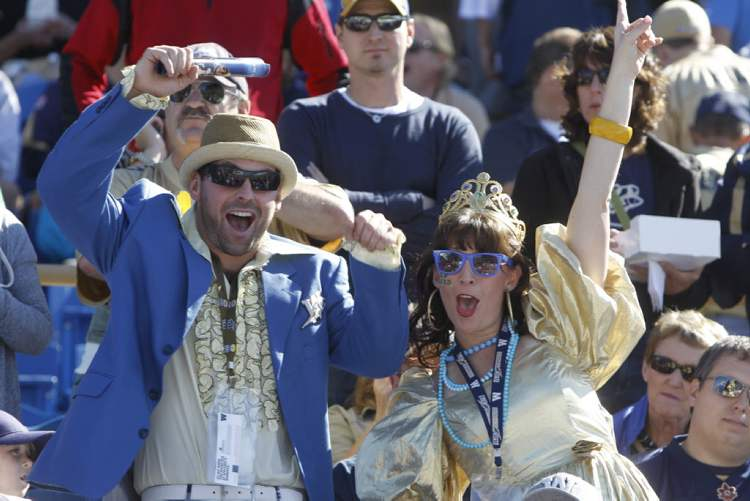 Fans cheer in the stands at the Banjo Bowl, Sunday.