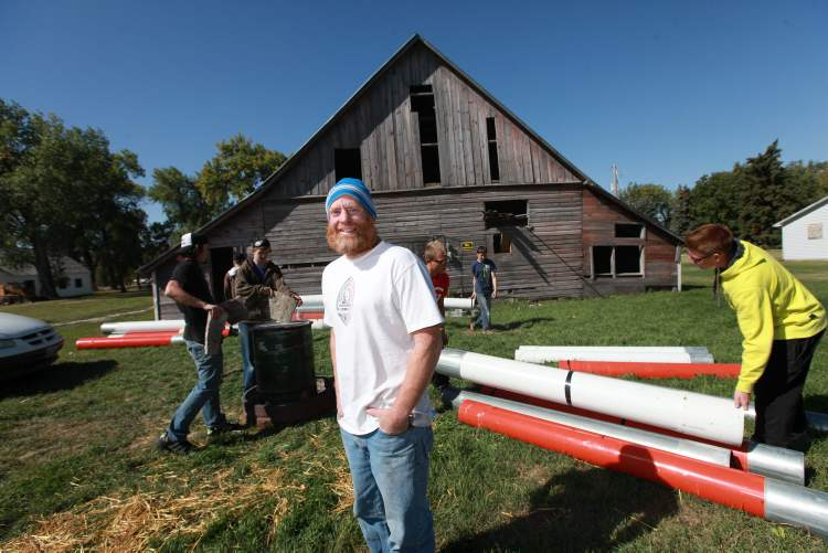 Teacher Bruce Friesen-Pankratz took students to the housebarn to demonstrate historic methods of energy production, such as making charcoal and briquettes and even manure bricks for producing even heat for cooking.