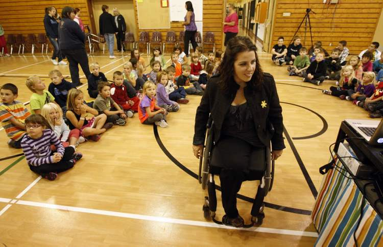 Cancer survivor Janis Ollson  talks to students in Balmoral., Man. Ollson was literally cut in half five years ago to remove an untreatable cancerous tumour. She spoke to the students about her life since the surgery, in preparation for the annual Terry Fox  Run.