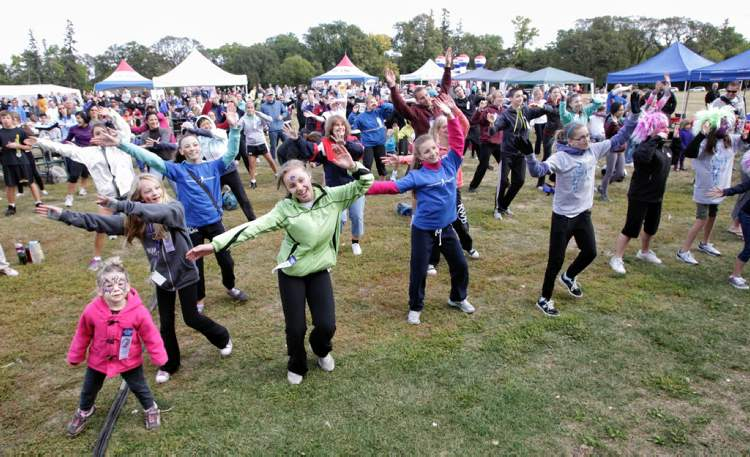 Participants warm up prior to the 32nd Annual Terry Fox Run at Assiniboine Park  in September 2012.