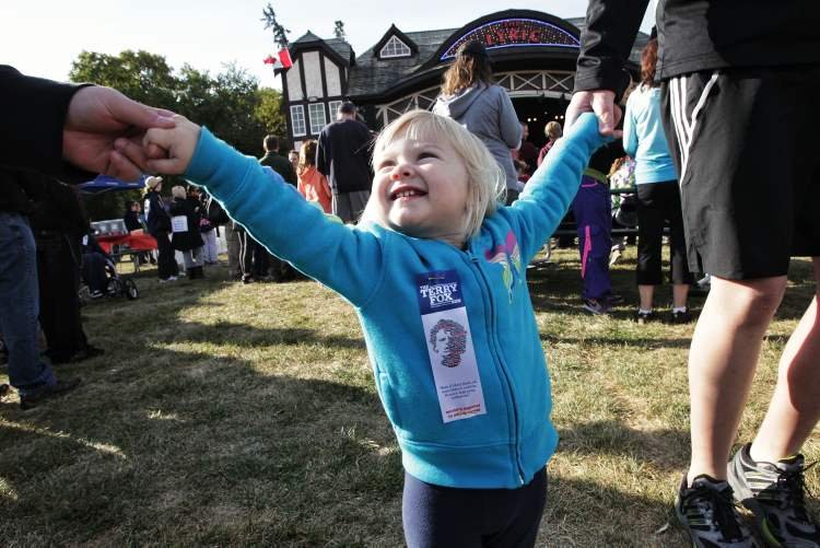 McKenna Didham, 20 months, dances to drum group Fubuki Daiko during the pre-run festivities at the 32nd Annual Terry Fox Run at the Assiniboine Park Sunday morning.  (Mike Deal / Winnipeg Free Press)