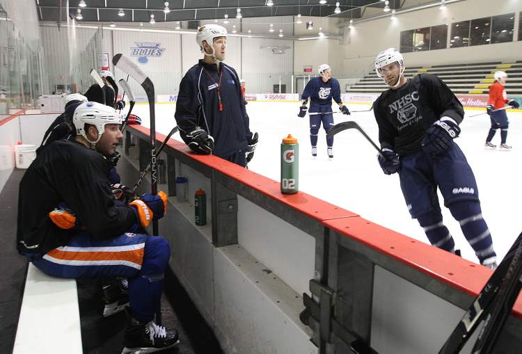 Locked out Winnipeg Jet Andrew Ladd, right, skates towards the bench  at practice Wednesday morning at the MTS Iceplex.