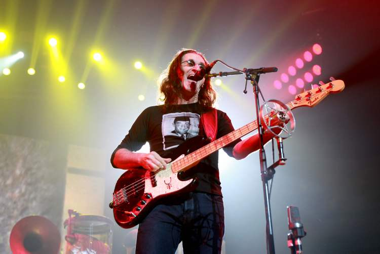 Rush lead vocalist Geddy Lee performs with his band  at the MTS Centre Wednesday evening. Known for classic Closer to the Heart and Roll the Bones, the Toronto band formed in 1968 and is currently on a 26-day North American tour.  (Ruth Bonneville / Winnipeg Free Press)